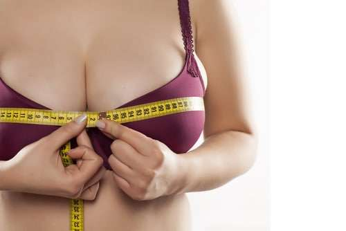 woman measuring bra size