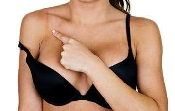 woman with fibromyalgia show the signs of bra that is hurting